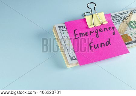Us Dollars In Paper Clip On Pastel Blue Background With Note Written Emergency Fund : Concept Of Set