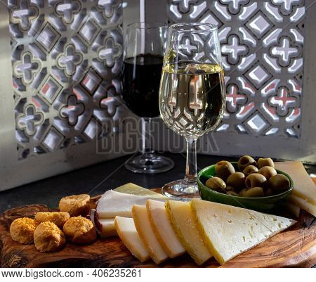 Tasting Of Fortified Andalusian Sherry Wine With Traditional Spanisch Tapas, Green Olives, Goat And