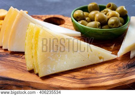 Spanish Snacks Tapas, Variety Of Sliced Goat, Sheep, Manchego Cheeses, Green Olives