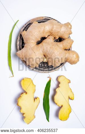 Fresh Ginger Rhizome Root Used In Traditional Medicines And For Flavoring Meals Isolated On White