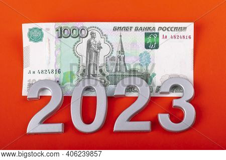 Close-up. Black Background. On It Are Numbers 2023 And A Bill Of 1000 Rubles. Russia.