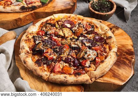 BBQ Pizza with Onions and Seasons Vegetables. Garnished on wooden tray