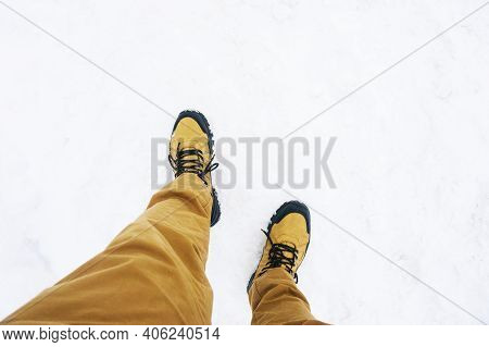 Trekking Shoes On Snow. Winter Mountain Trekking. White Ground Covered With Snow. Walking On Snow Ro