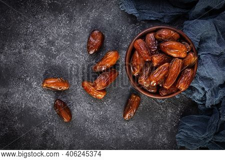 Dried Date Fruit In Bowl On Wooden Background. Delicious Dates Fruit. Top View