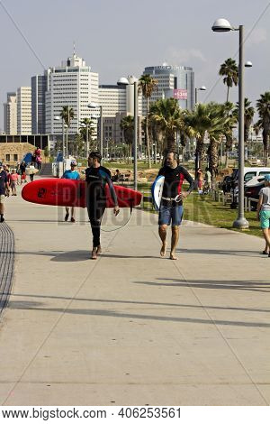 Tel Aviv, Israel, November 2019 - Surfer, Surfers In The Sea Are Waiting For Water . Surfer At Sea