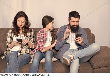 Online Family Meeting. Little Child And Parents Use Cellphones At Home. Mobile Communication. Cellul