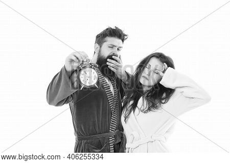 Tired Family Couple. Sleepless Man And Woman In Bathrobe. Morning Wakeup. Morning Alarm. Couple Hold