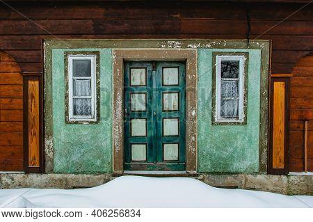 Metal Door Handle.beautiful Vintage Colorful Painted Door.blue Green Grunge Wooden Door In Brick Wal