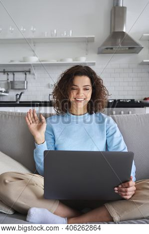 Happy Hispanic Teen Girl Waving Using Laptop Computer Enjoying Online Virtual Chat Video Call With F