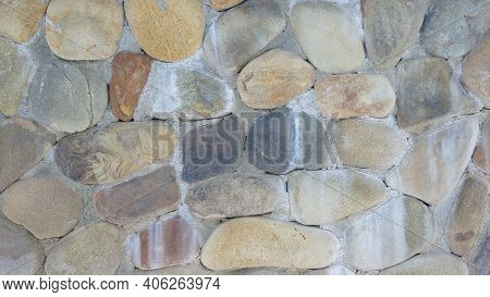 Rounded Colored Stones Wall Close Up. Rounded Colored Stone Walls Texture. Rounded Colored Stone Wal