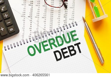 Writing Text Showing Overdue Debt. Writing Text Overdue Debt On White Paper Card, Green And Black Le