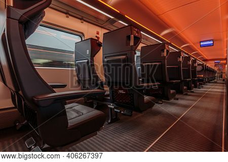 Side View Into A Train Compartment Of A German Railroad Car. First Class Without Passengers While Dr