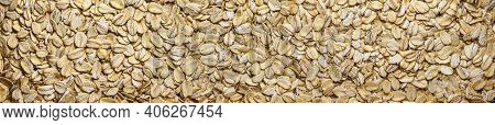 A Close-up Of A Spelt Cereal Flakes For Breakfast. Panoramic Background Of Oat Flakes.