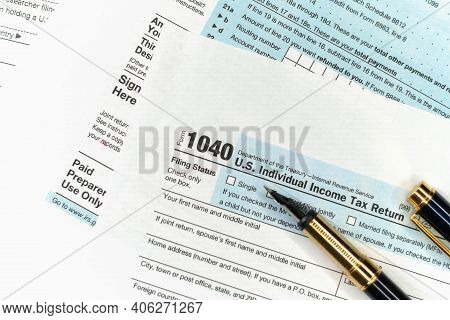 1040 Tax Form. Tax Payment Concept. Filing Taxes Document On Table In Office. Individual Income Tax
