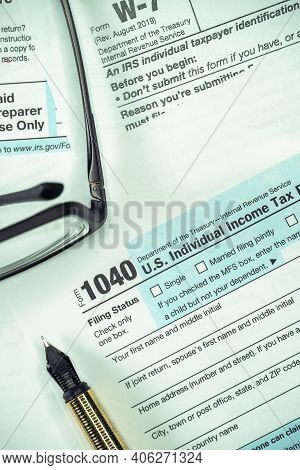 Filling Us Tax Form. Tax Form Usa Business Income Office Concept. Tax Return Form 1040. Vertical Pho