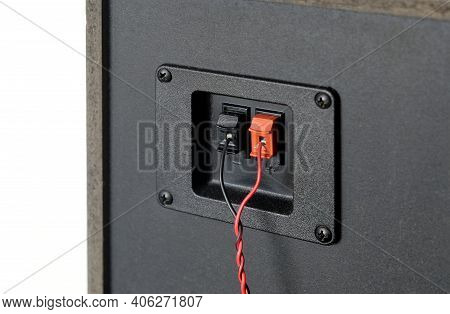 Red And Black Twisted Wire Connected To Connection Socket On Rear Side Of Speaker System Box Side Vi