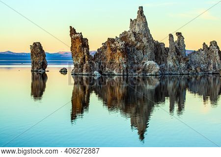 Magic reflections of tuff outliers in lake water. Lime-tuff towers of bizarre shapes rise from the bottom of the Lake Mono.