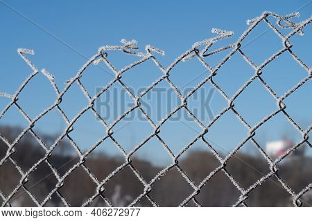 Against The Background Of The Blue Sky, The Netting Netting Covered With Frost, Winter Background
