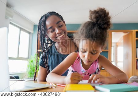 Mother Helping And Supporting Her Daughter With