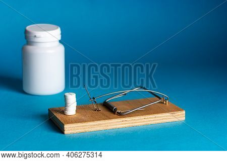 Mousetrap With Pharmaceutical Drugs, Tablets, Pills. Pills, Pills, Medicine Inside The Mousetrap. Ad