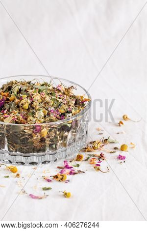 Dry Medicinal Herbs And Blooms On Beige Background. Homeopathy And Herbal Medicine Concept