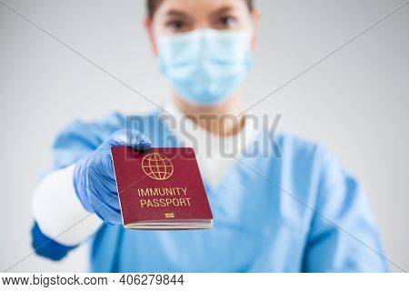 Uk Nhs Doctor Holding Red Global Immunity Passport,sars Re-infection Risk-free Certificate Concept,r