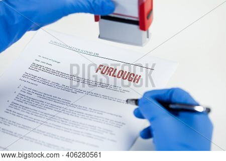 Hr Hand In Blue Protective Glove Stamping Furlough Notice Letter,temporary Unpaid Leave,absence Of E