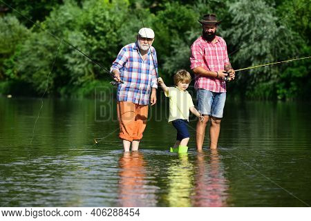 Fishing. Little Boy Fly Fishing On A Lake With His Father And Grandfather. Happy Grandfather And Gra