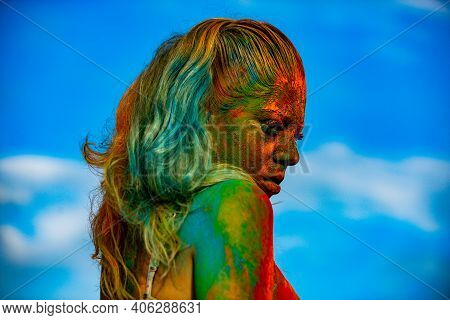 Color Face With Colorful Holi Splash. Fashion Model Girl Portrait With Colorful Powder Make Up. Vogu