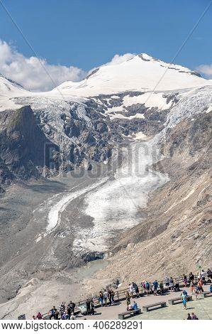 Grossglockner, Austria - Aug 8, 2020: Tourists Admire Pasterze Glacier At Kaiser Franz Josefs Viewpo
