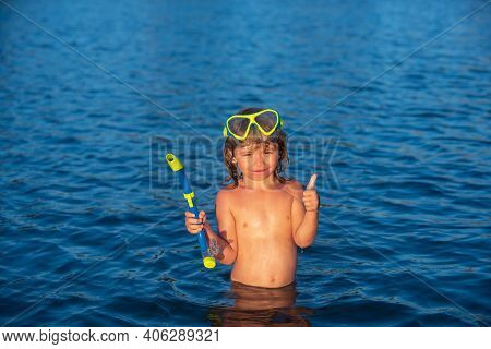 Boy Kid Swim On The Beach On Summer Holidays. Child In Sea. Happy Kids Swimming In The Water. Little
