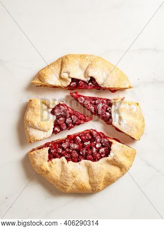 Perfect Cut Raspberry Galette. Delicious Rustic Homemade Tart With Frozen Or Fresh Raspberries On Wh