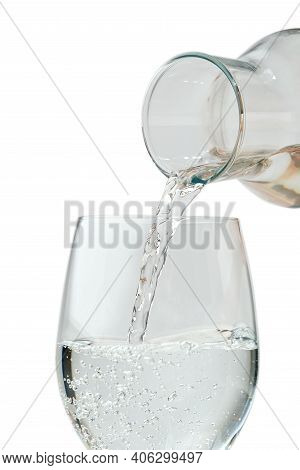 Pouring Water. Pouring Drinking Water From A Glass Decanter To Glass.