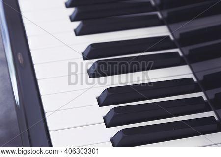 Piano Keys Close-up. Ebony And Ivory Colored Piano Keys.