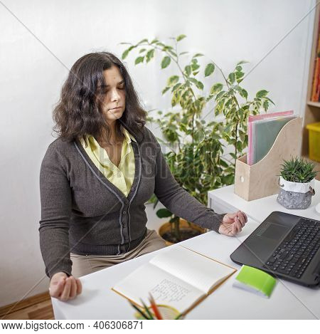 Woman Doing Revitalizing Exercising To Reduce Stress During Distant Work From Home In Quarantine, Me