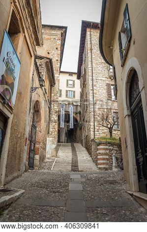 Brescia, Italy - December, 2015: Beautiful Narrow Alley With Upstairs In Brescia City. Historical Ar