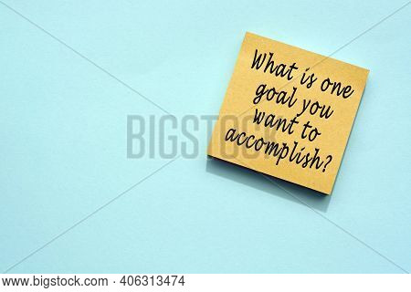 Text On Yellow Sticky Note With Blue Background. Accomplishment Concept