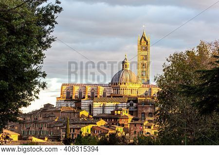 Sunset. Siena Cathedral Duomo. Important artistic and historical monument of the Italian Gothic.  The old city center of Siena. Italy.