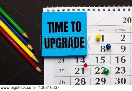 The Calendar Has Light Blue Note Paper With The Text Time To Upgrade. Nearby Colored Pencils On A Da