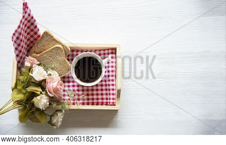 Fresh Morning Coffee With Bread, Rose In Tray On The Bed, Early Work Day . Lifestyle Concept
