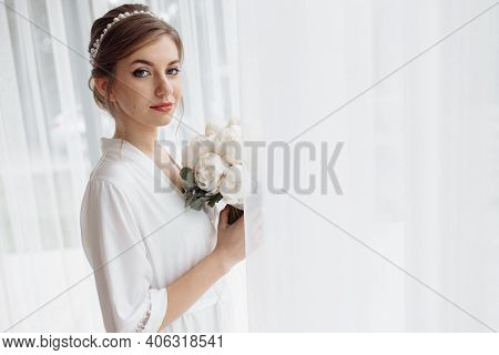 Beautiful Bride With A White Robe Is Going At Home. Fees Of The Bride. Wedding Day Of The Newlyweds.
