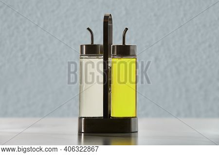 Two Bottles With Dispenser Spout For Cooking Oil Or Vinegar In Metal Holder.