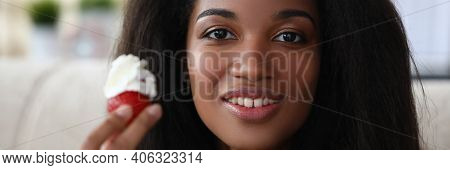 Portrait Of Happy Smiling Brunette Afro American Woman Holding Mellow Strawberry. Cheerful Lady Posi