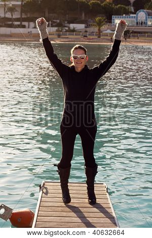 Happy Woman Standing On A Pier