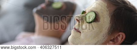 Close-up Of Wife And Husband Wearing Cleaning And Moisturizing Face Masks. Relaxed Female And Male L