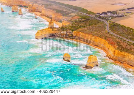 Australia. Aerial view. Great Ocean Road. Helicopter flight over the scenic Pacific coastline. The Twelve Apostles are a group of limestone rocks in the Pacific Ocean near the coast.