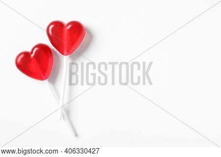 Sweet Heart Shaped Lollipops On White Background, Flat Lay With Space For Text. Valentine's Day Cele