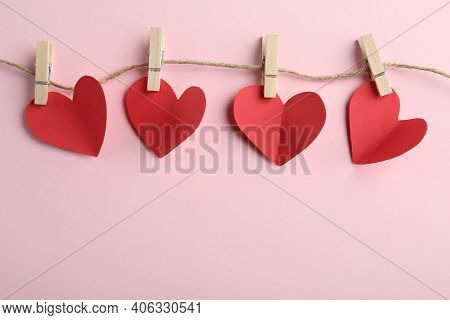 Red Hearts, Rope And Clothespins On Pink Background, Top View With Space For Text. St. Valentine's D