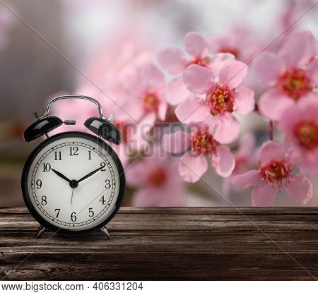 Black Alarm Clock On Wooden Table, Space For Text. Daylight Saving Time (spring Forward)
