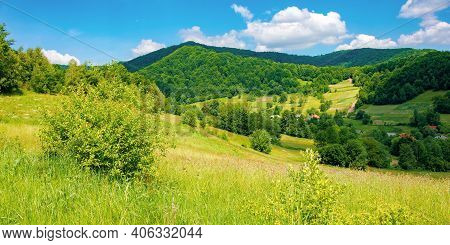 Rural Landscape Of Ukrainian Carpathians. Beautiful Summer Scenery In Mountains. Green Grassy Meadow